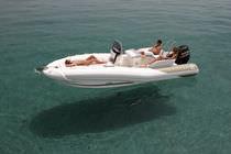 Bateau pneumatique à console latérale / semi-rigide / bain de soleil