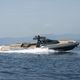 bateau pneumatique in-bord / semi-rigide / à console centrale / en fibre de verre