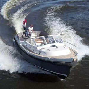 cabin-cruiser in-bord / open / fluvial / en fibre de verre